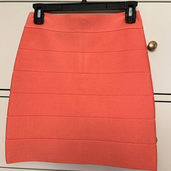 bebe Dresses & Skirts - Bebe Coral mini bandage skirt M